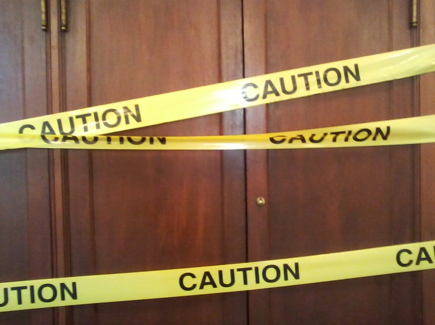 caution tape over door